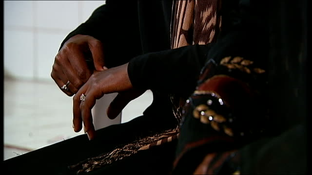 The African Exodus Migrants caught in lawless Libya Tripoli INT 'Aster' interview SOT Hands 'Aster' putting hand to face Eritrean migrants Location...