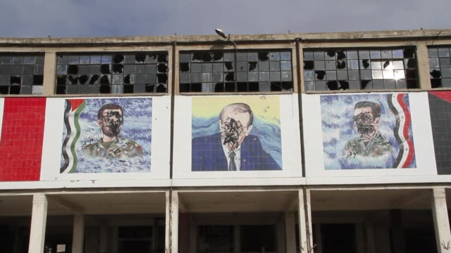 Destroyed murals of the Assad family members in Aleppo Syria