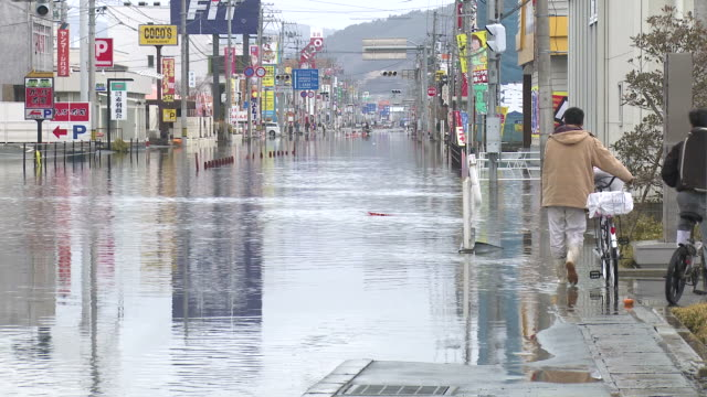 Destruction caused by tsunami after magnitude 9 Tohoku earthquake, north east Japan, March 2011. Sea water floods downtown Ishinomaki, Miyagi Prefecture at high tide after tsunami