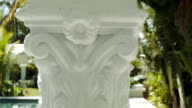 Detail footage of a design on one of the support beams in the pool cabana