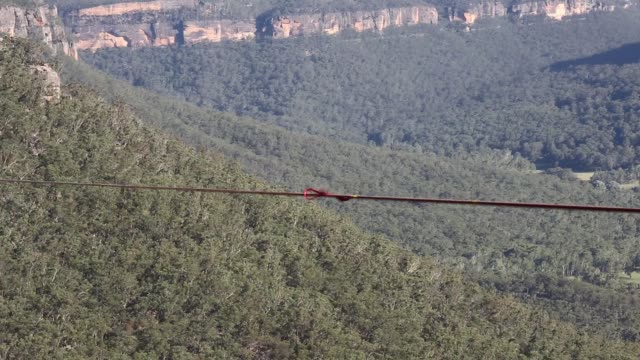 Detail of a highline blowing in the wind rigged between cliffs at Corroboree Walls in Mount Victoria on March 6 2015 in the Blue Mountains Australia...