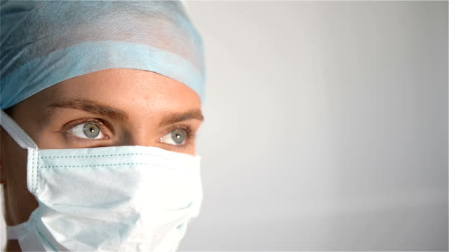 Detail of female doctor wearing surgical mask