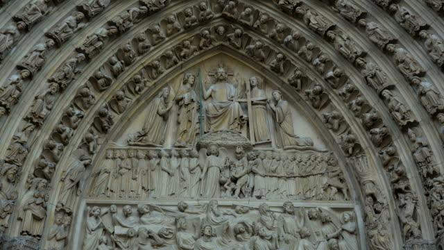 Details cat Entrance Portal of Notre Dame Cathedral, Paris, Ile de France, France