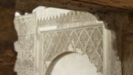 LS details of arabesque stone carvings seen through one of the arches of the women's gallery