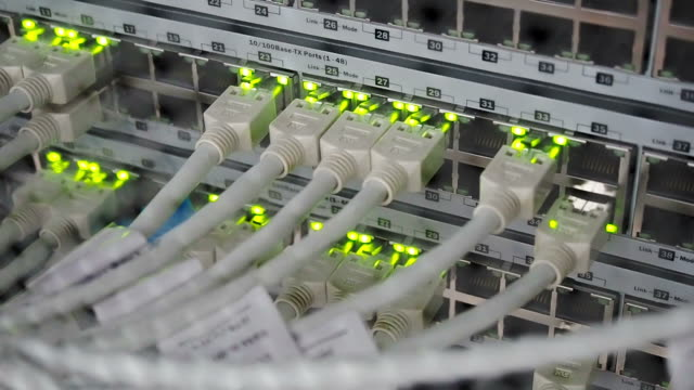 Details of UTP cables, blinking LED lights and RJ 45 on working Ethernet switches