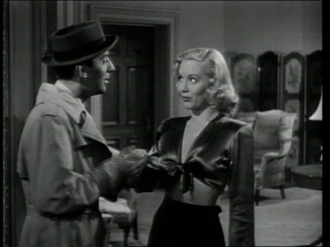1948 MS Detective talking with seductive woman of the house / United States