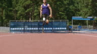 Determined amputee athlete running on track