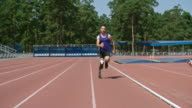Determined amputee runner training for Paralympics