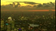 Developers avoiding commitments to build affordable housing LIB / City of London skyline at night including Canary Wharf