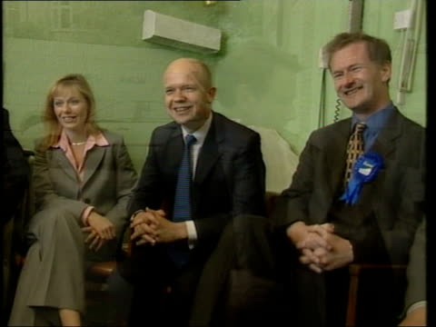 Devon Torbay EXT TCMS SIDE Conservative Party Leader William Hague along shaking hands with people held back behind blue rope PULL OUT CMS Hague and...