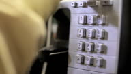 Dialing a Pay-Phone