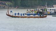 1200 1230 Crowds lining River Thames / Union Jack branded boat at Putney / Spirit of Chartwell off Putney / Crowds along embankment at Putney / Boats...