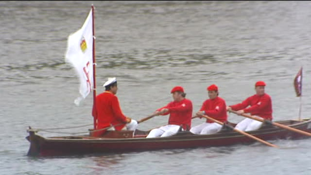 1300 1330 ENGLAND London River Thames EXT Crowds along shore in Cadogan / Rowing boats setting off from Putney including boat with 'ERII' Flag / Ship...