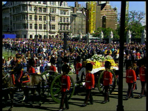 Part 3 TX 691997 ENGLAND London Coffin draped in flag transported along on horsedrawn hearse past crowds of mourners lining streets Queen Pincess...