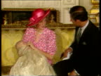 Part 5 116450 Prince William Christening photocall Diana side in pink hat and dress putting finger in baby Prince William's mouth camera pulls out as...