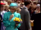 Part 5 INJ1647E Prince and Princess of Wales Location unknown Diana Princess of Walesin turquoise dress and hat walking past Prince Charles to talk...
