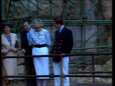 Part 5 INJ2582 A touch of familiarity on Italian tour Prince Charles and Princess Diana by railings Prince Charles looks at dirty hand zoom in as he...