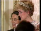 Part 5 R03119207 Banquet held for Royal couple on South Korean visit SOUTH KOREA Seoul Close shot of Diana in evening dress greeting people longer...