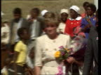 Part 5 R12079315 Princess Diana makes trip to Zimbabwe ZIMBABWE Nemazuva Diana with children behind her zoom in Diana doling out food to children at...
