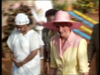 Part 5 SPL0627 Diana On Her Own Walking shot of Princess Diana Location unknown Diana in pink hat pink yellow outfit walking right to left