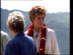 Part 5 T03039311 Princess of Wales makes solo trip to Nepal on behalf of Red Cross NEPAL Himalaya Foothills Diana in pale shirt with garland round...