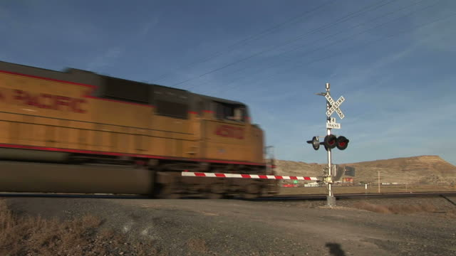 Diesel locomotives passing a rural level crossing in Wyoming United States