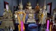 Different Buddha figures in temple