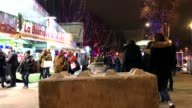 Different view of christmas market at night in Paris France at Champs Elysées Emergency vehicle anti attack road blocks are visible