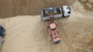 Digger Offloading Gravel