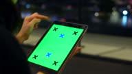 Digital green screen tablet at night
