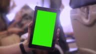 Digital tablet on a plane. Chromakey.