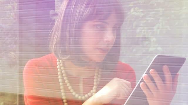 Digital tablet through a window. Retro styling.