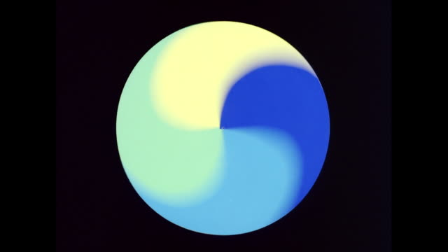 CU Digitally generated of blue and yellow coloured art equipment spinning speedily / United States