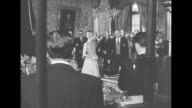 Dignitaries file into throne room with Grace Kelly followed by parents John and Margaret Kelly / seated Kelly parents / Rainier and Grace take places...
