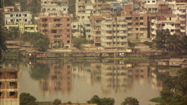 WS, Dilapidated cityscape across river, Dhaka, Bangladesh