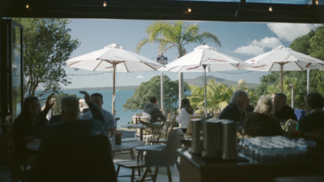 Diners at restaurant on Takapuna Beach