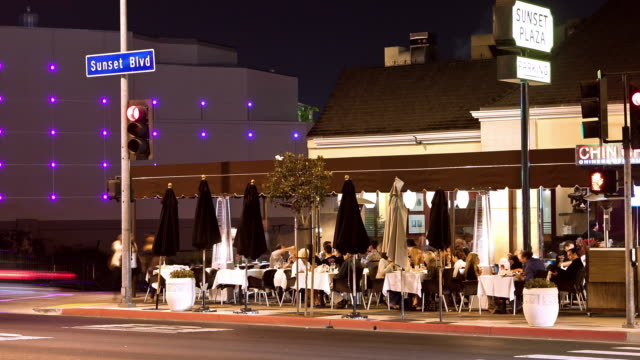 WS T/L Diners sitting at outdoor tables of hip restaurant in Sunset Plaza district of the Sunset Strip at night / West Hollywood, California, USA