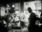 1951 WS director coaching actors prior to filming a scene