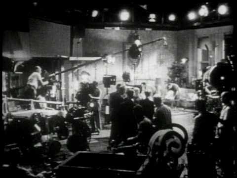 1951 MS director, film crew, and actors bustling on the sound stage of a film