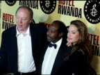 Director Terry George Paul Rusesabagina and Angelina Jolie at the 'Hotel Rwanda' Los Angeles Premiere at the Academy Theatre in Los Angeles...