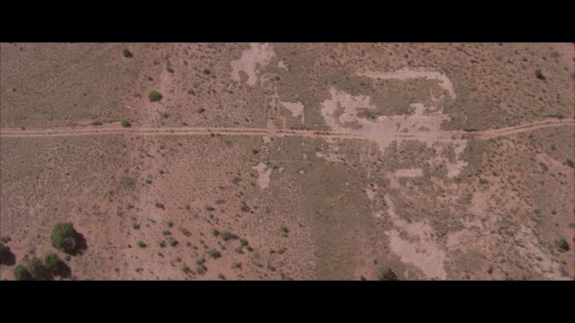 AERIAL VIEW, CIRCLING, Dirt road on flat landscape