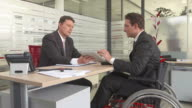 HD DOLLY: Disabled Businessman Having Meeting