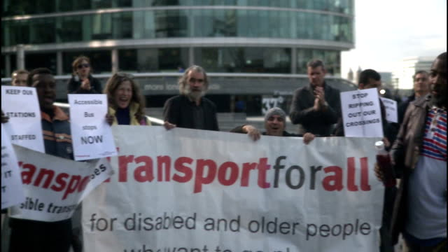 Disabled passengers campaign for better access EXT Wayne Trevor interview SOT Disability campaigner addressing other campaigners on megaphone SOT GVs...
