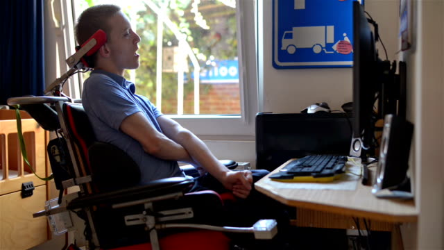 Image result for images of a paraplegic using a computer