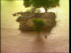 Floods CF TAPE NO LONGER AVAILABLE PAKISTAN AIRV Flooded farmland TRACK LR AIRV Floodwater covers road TRACK FORWARD AIRV Farmer and oxen in flooded...