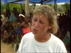 Relief problem TMS People sitting standing around in camp MS Nurse walking amogst children smiling MCU Nurse interviewed SOT seeing improvements...