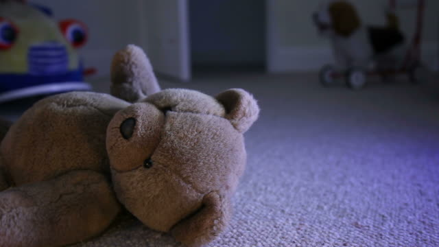 Discarded Teddy bear, child's room.