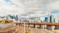 Discovering Australia: Time lapse of Melbourne skyline from North Melbourne with trains