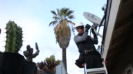 A Dish Network technician performs an installation upgrade for a customer at their suburban home in Downey California on November 1st 2015 Shots A...