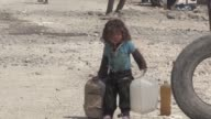 Displaced civilians at Syria's Ain Issa IDP camp some 50 kilometres north of Raqa face difficult living conditions made even worse by the scorching...